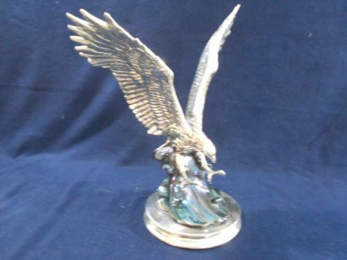 Águila en Ola en ARTESANÍAS de plata