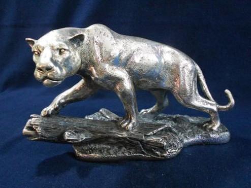 Jaguar en tronco en ARTESANÍAS de plata